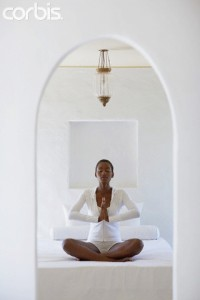 Woman meditating --- Image by © Felix Wirth/Corbis
